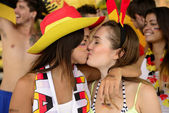 German lesbian soccer fans kissing each other — Foto Stock