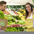 Happy couple shopping organic fruits and vegetables — Stock Photo