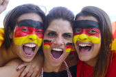 Group of happy german soccer fans — Stock Photo