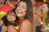 Happy couple of girlfriends sport soccer fans — Stock Photo
