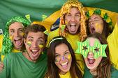 Happy group of Brazilian sport soccer fans — Stock Photo