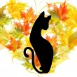 Graceful cat on the background of the heart of autumn leaves — Image vectorielle