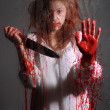 Horror Themed Image With Bleeding Freightened Woman — Stock Photo #12721316