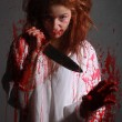 Horror Themed Image With Bleeding Freightened Woman — Stock Photo #28030609