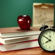 Lunch, Apple, Books and Clock on Desk at School — Stock Photo