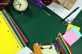 Back to School Items Arranged on a Green Blackboard — Stock Photo