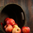 Barrel Full of Red Apples on Wood Grunge  Background — Stock Photo