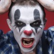 Spooky Clown Portrait on Red Background — Stock Photo