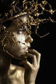 Beautiful Gold Painted Woman in Conceptual Beauty Themed Image — Stock Photo