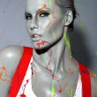 Female House Painter Splattered with Latex Paint — Stock Photo