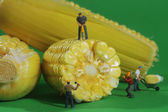 Miniature Construction Workers in Conceptual Food Imagery With C — Stock Photo
