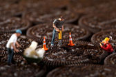 Construction Workers in Conceptual Imagery With Cookies — Stock Photo