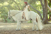 Woman Outdoors With a White Horse — Stock Photo