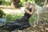 Lovely Woman Posing With a Wolf  — Stockfoto