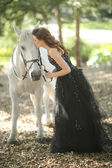 Woman Outdoors With a White Horse — Stok fotoğraf