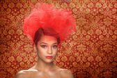 Striking Red Themed Woman With Creative Headpiece — Stock Photo