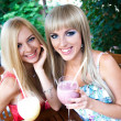 Pretty young women in a cafe — Stockfoto