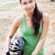 Beautiful young woman riding a bicycle — Stock Photo #12715747