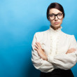 Strict woman in large glasses — Stock Photo #12884196