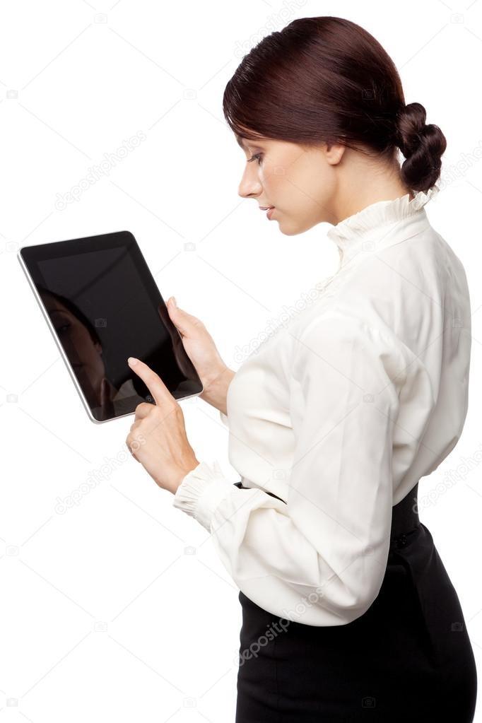 Attractive young woman with a tablet pc, white background  Stock Photo #12884190
