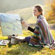 Young artist painting a landscape — Stock Photo #13781055