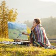 Young artist painting a landscape — Stock Photo #13781058