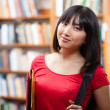 Royalty-Free Stock Photo: Beautiful female student in a library