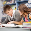 Students in a library — Stock Photo #14036578
