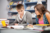 Students in a library — Foto Stock