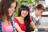 Group of students in a classroom — Stock Photo