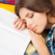 Beautiful female student in a library — Stock Photo #14284821