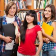 Group of students in a library - Stock Photo