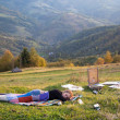 Young artist sleeping in a meadow - Stock Photo