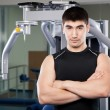 Stock Photo: Trainer in fitness center