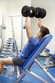 Handsome man with dumbbells — Stock Photo