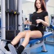 Slim woman training in a gym - Stock Photo