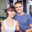 Young couple in a gym — Stock Photo