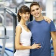 Young couple in a gym — Stock Photo #18672251