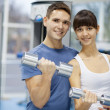 Young couple in a gym — Stock Photo #18672253