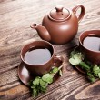 Tea with mint on a wooden table — Photo