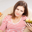 Slim woman choosing between a salad and hamburger — Stock Photo
