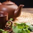 Tea with mint on a wooden table — Stock Photo