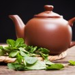Tea with mint on a wooden table - Stock Photo