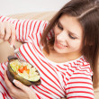 Beautiful young woman eating a salad — Stock Photo #19669083