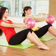 Group training in a gym of a fitness center — Stock Photo #19669095