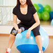 Woman in a gym on a ball — Stock Photo #19669111
