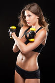 Slim woman with dumbbells — Stockfoto