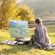 Painter in the mountains — Stock Photo