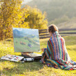 Stock Photo: Painter in the mountains