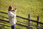 Female photographer shooting in open air — Stock Photo